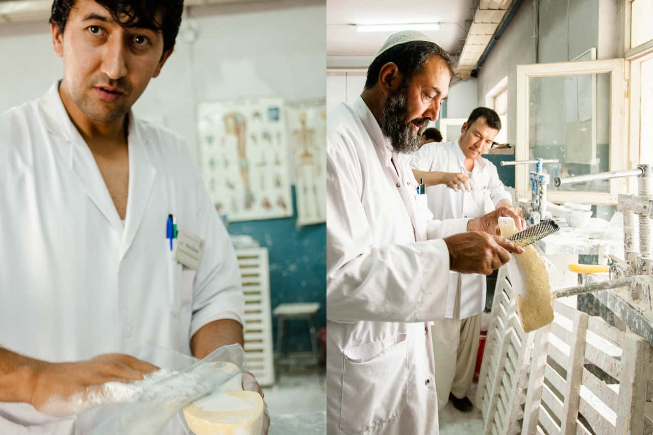 ICRC employees working on shaping molds of feet for prothetics