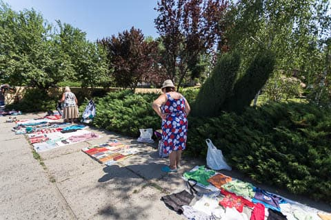 Women selling used clothes and books in the park