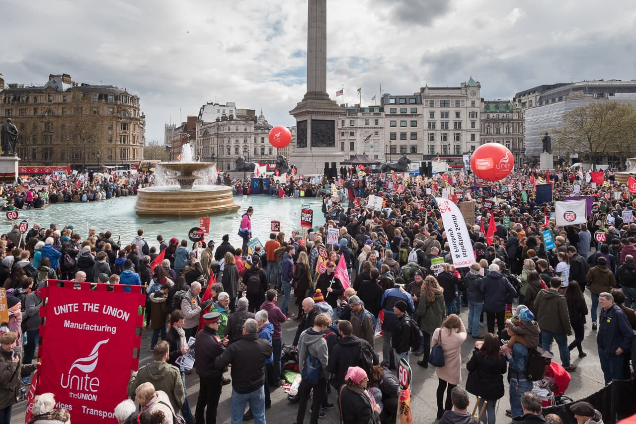 Overview of the protestors around the fountain in Tafalgar Square, London